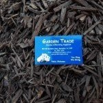 black dyed mulch showing a melbourne garden supplies in mordialloc, business card