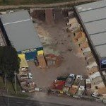 BAYSIDE, GARDEN,SUPPLIES melbourne, aerial view, showing 5 delivery trucks near me and 42 bulk bins of landscaping supplies