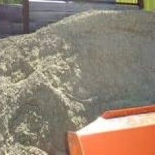 crushed rock in bin being loaded by garden supplies earthmover located in mordialloc melbourne