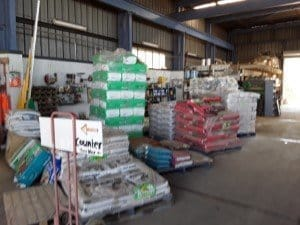 pallets of potting mix and fertilisers inside ideal garden supplies business at mordialloc, melbourne