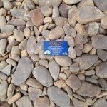 small-flat-brown river pebbles with a boundary rd mordialloc, garden supplies business card